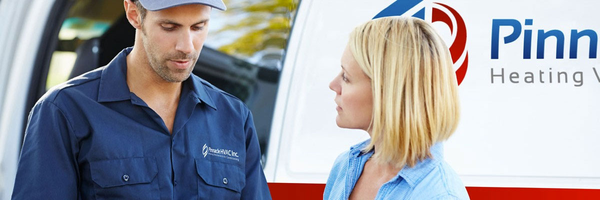 Pinnacle HVAC Truck with service technician and customer