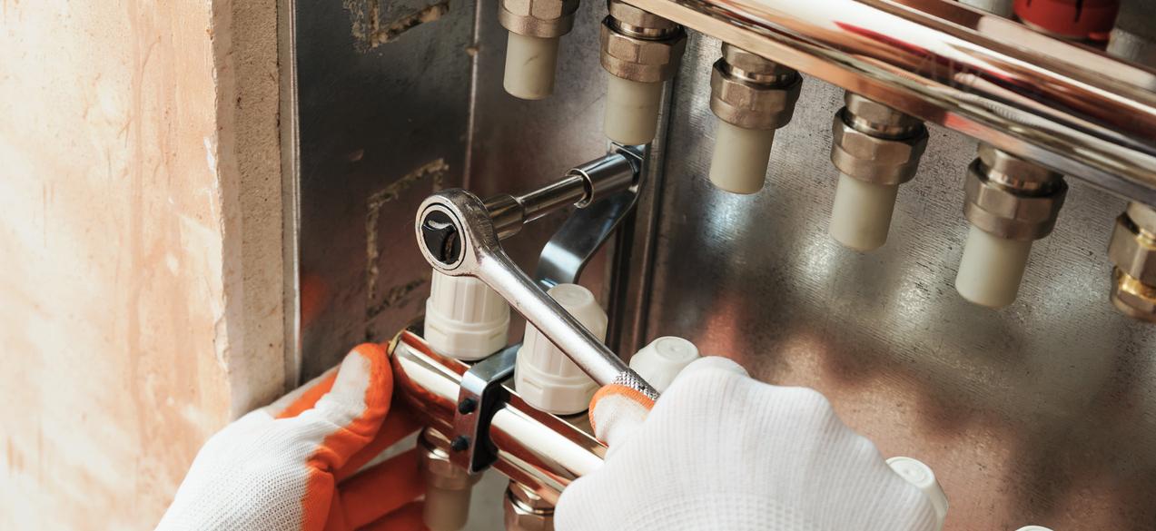 Oil burner being repaired by Pinnacle HVAC- Heating, Ventilation