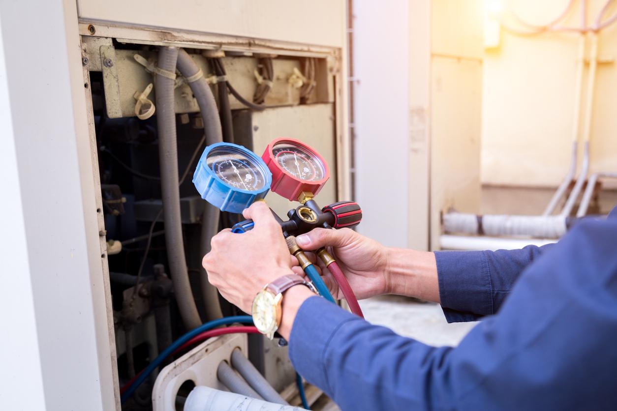 photo of a Pinnacle AC Repair tech repairing an AC system
