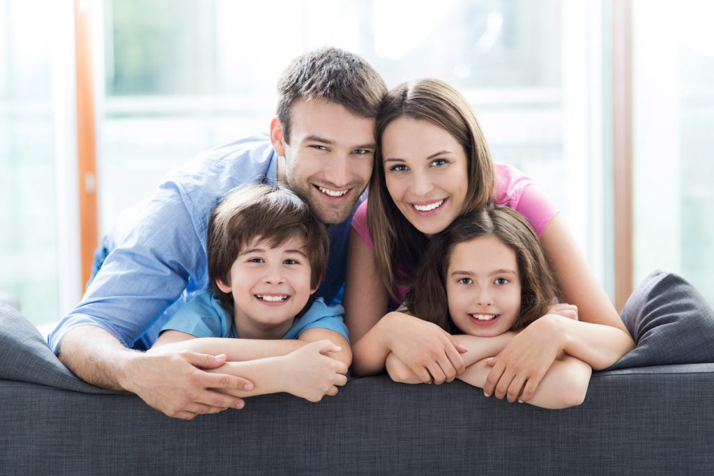 family of four comfortable in their home